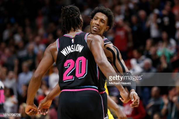 Josh Richardson of the Miami Heat celebrates with Justise Winslow against the Milwaukee Bucks during the second half at American Airlines Arena on...