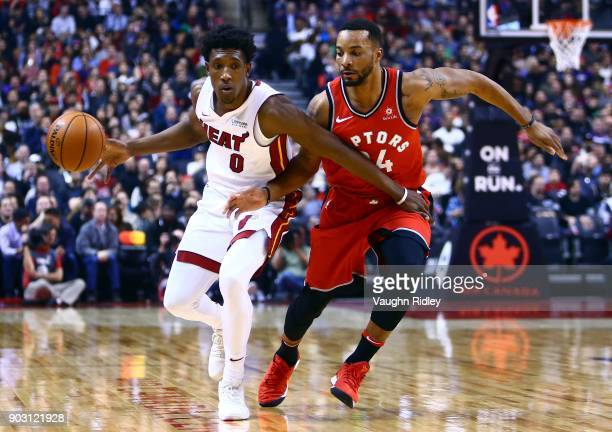Josh Richardson of the Miami Heat dribbles the ball as Norman Powell of the Toronto Raptors defends during the first half of an NBA game at Air...