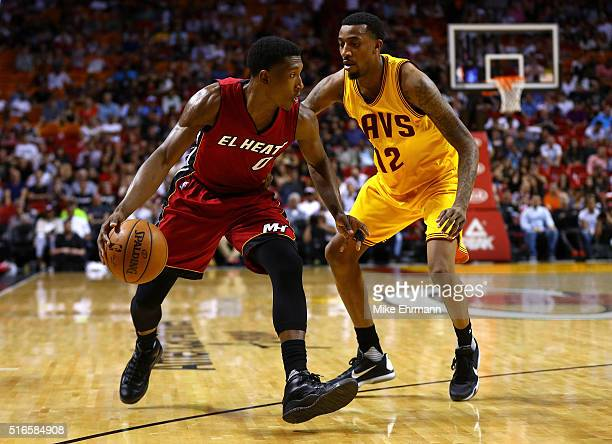 Josh Richardson of the Miami Heat drives on Jordan McRae of the Cleveland Cavaliers during a game at American Airlines Arena on March 19 2016 in...
