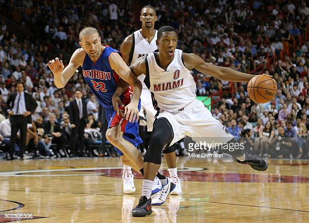 Josh Richardson of the Miami Heat drives on Steve Blake of the Detroit Pistons during a game at American Airlines Arena on December 22 2015 in Miami...