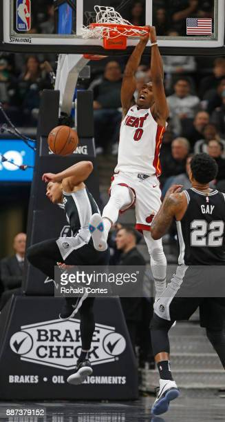 Josh Richardson of the Miami Heat dunks over Bryn Forbes of the San Antonio Spurs at ATT Center on December 06 2017 in San Antonio Texas NOTE TO USER...