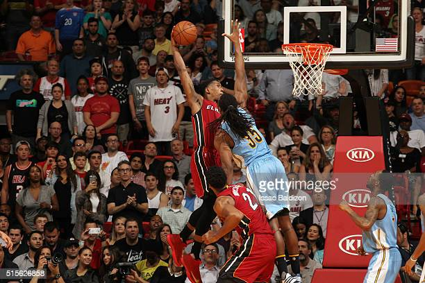Josh Richardson of the Miami Heat goes up for a dunk against the Denver Nuggets on March 14 2016 at American Airlines Arena in Miami Florida NOTE TO...