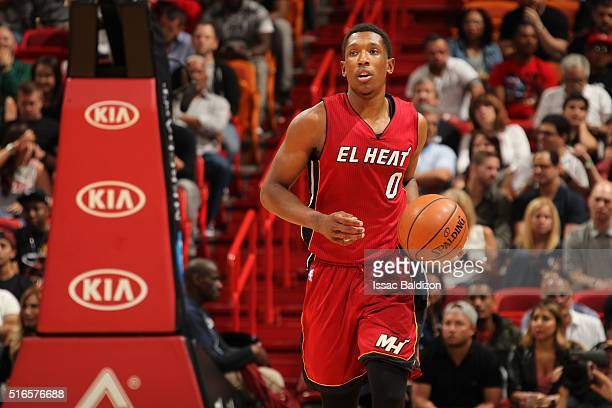 Josh Richardson of the Miami Heat handles the ball against the Cleveland Cavaliers on March 19 2016 at AmericanAirlines Arena in Miami Florida NOTE...