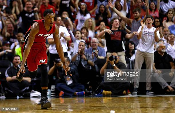 Josh Richardson of the Miami Heat reacts to a three pointer during a game against the Cleveland Cavaliers at American Airlines Arena on March 19 2016...