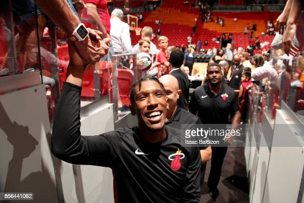 Josh Richardson of the Miami Heat shakes a fans hand after the preseason game against the Atlanta Hawks on October 1 2017 at American Airlines Arena...