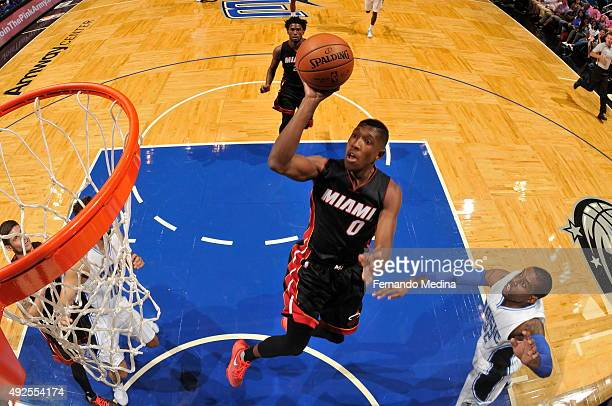 Josh Richardson of the Miami Heat shoots against the Orlando Magic during a preseason game on October 13 2015 at Amway Center in Orlando Florida NOTE...