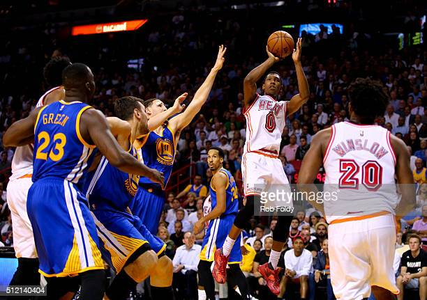 Josh Richardson of the Miami Heat shoots during the game against the Golden State Warriors at the American Airlines Arena on February 24 2016 in...