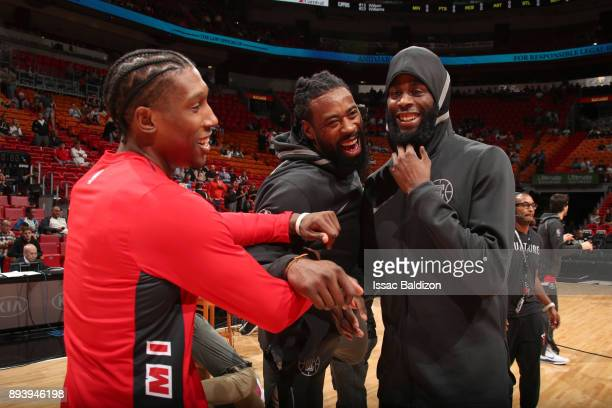 Josh Richardson of the Miami Heat with DeAndre Jordan and Willie Reed of the LA Clippers before the game on December 16 2017 at American Airlines...