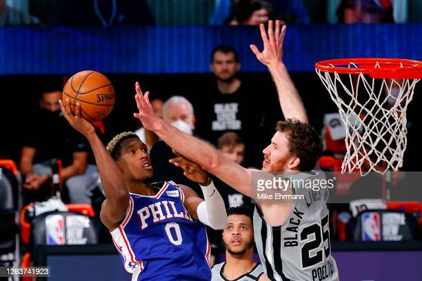 Josh Richardson of the Philadelphia 76ers attempts a shot against Jakob Poeltl of the San Antonio Spurs during the third quarter at Visa Athletic...