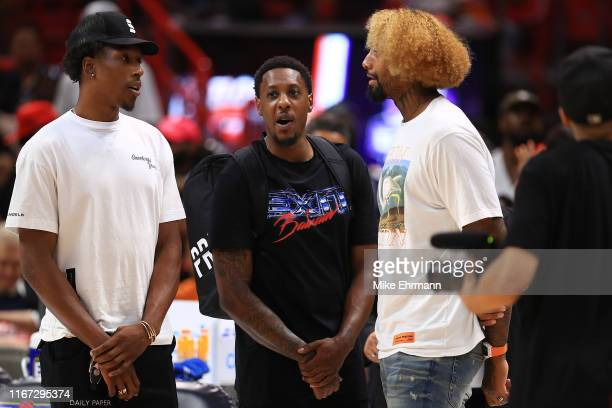 Josh Richardson of the Philadelphia 76ers, Mario Chalmers of the 3 Headed Monsters, and James Johnson of the Miami Heat look on during week eight of...