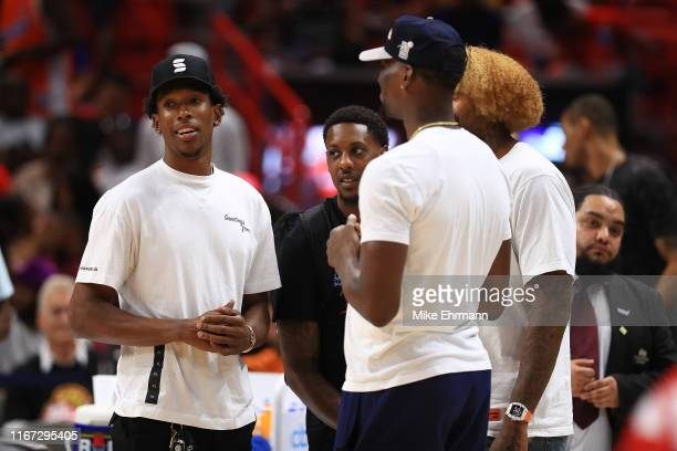Josh Richardson of the Philadelphia 76ers, Mario Chalmers of the 3 Headed Monsters, Bam Adebayo and James Johnson of the Miami Heat look on during...