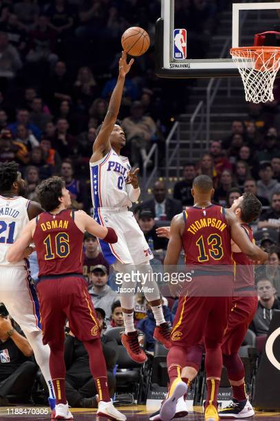 Josh Richardson of the Philadelphia 76ers shoots over Cedi Osman Tristan Thompson and Kevin Love of the Cleveland Cavaliers during the first half at...