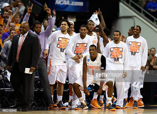 Josh Richardson of the Tennessee Volunteers celebrates with teammates late in the game against the Mercer Bears during the third round of the 2014...