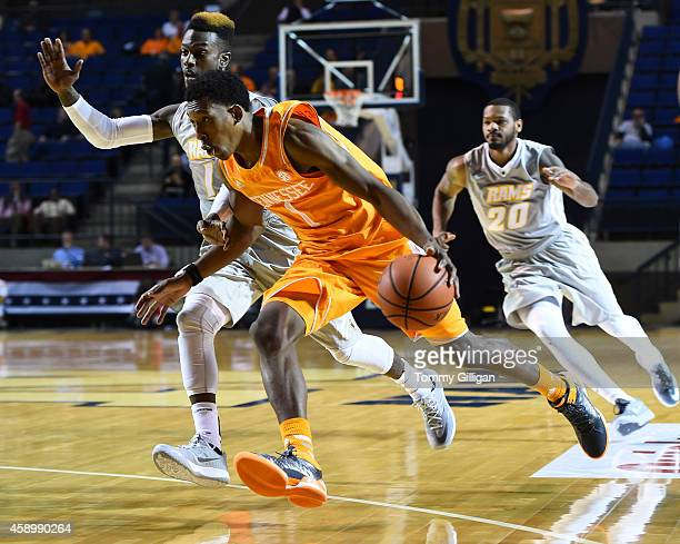 Josh Richardson of the Tennessee Volunteers drives to the next as JeQuan Lewis of the Virginia Commonwealth Rams defends during the first half at the...
