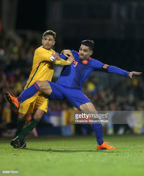 Josh Risdon of Australia and Tomi Juric of Colombia battle for the ball during the International Friendly match between Australia and Colombia at...