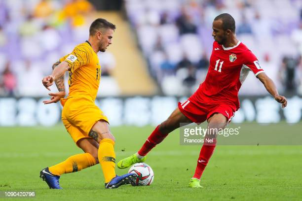 Josh Risdon of Australia competes for the ball with Yaseen AlBakhit of Jordan during the AFC Asian Cup Group B match between Australia and Jordan at...