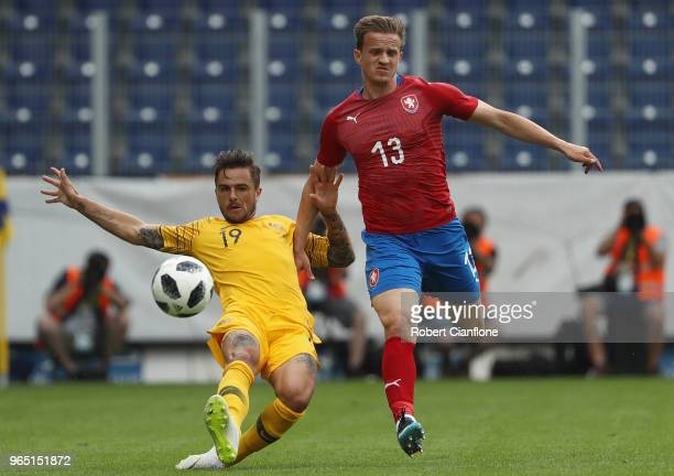 Josh Risdon of Australia is challenged by Jan Kopic of the Czech Republic during the International Friendly match between the Czech Republic and...