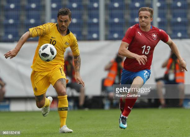 Josh Risdon of Australia is chased by Jan Kopic of the Czech Republic during the International Friendly match between the Czech Republic and...