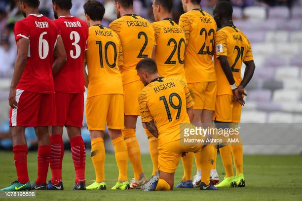 Josh Risdon of Australia kneels behind the wall during the AFC Asian Cup Group B match between Australia and Jordan at Hazza Bin Zayed Stadium on...