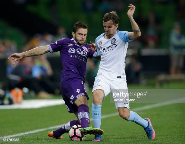 Josh Risdon of Perth Glory and Nicolas Colazo of Melbourne City compete during the ALeague Elimination Final match between Melbourne City FC and the...