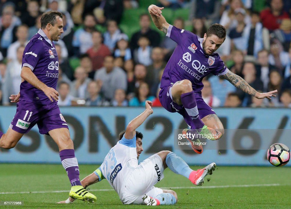 Josh Risdon of Perth Glory jumps over Bruno Fornaroli of Melbourne City during the A-League Elimination Final match between Melbourne City FC and the Perth Glory at AAMI Park on April 23, 2017 in Melbourne, Australia.