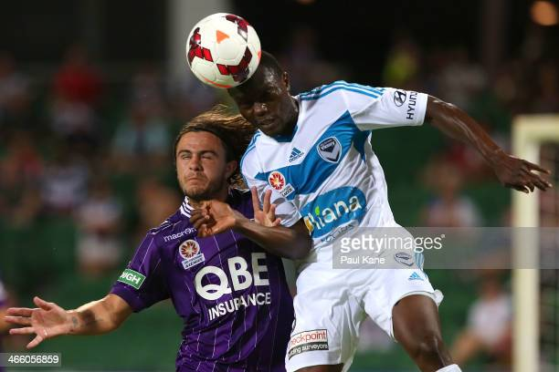 Josh Risdon of the Glory and Adama Traore of the Victory contest for the ball during the round 17 ALeague match between Perth Glory and Melbourne...