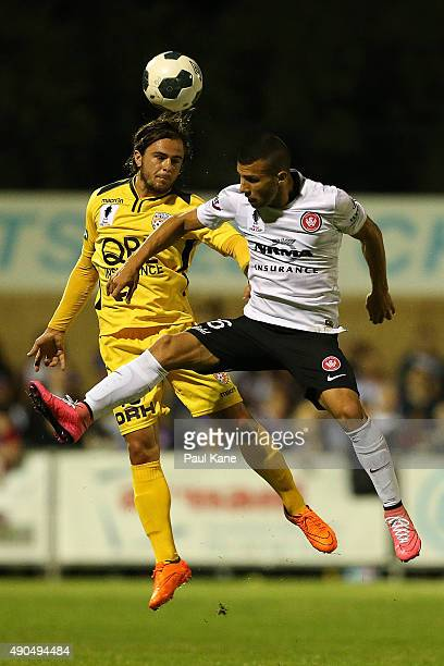 Josh Risdon of the Glory and Jaushua Sotirio of the Wanderers contest for a header during the FFA Cup Quarter Final match between the Perth Glory and...