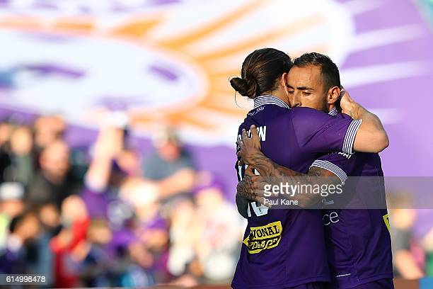 Josh Risdon of the Glory congratultes Diego Castro after kicking a goal from a penalet during the round two ALeague match between the Perth Glory and...