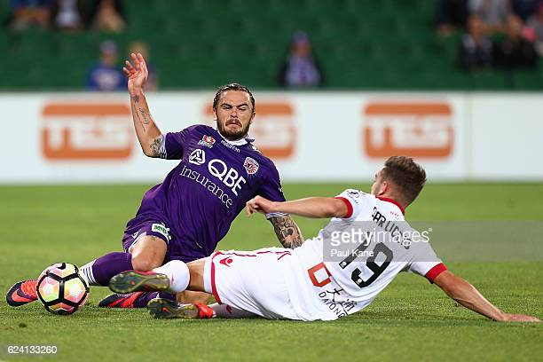 Josh Risdon of the Glory is tackled by Ben Garuccio of Adelaide during the round seven ALeague match between the Perth Glory and Adelaide United at...