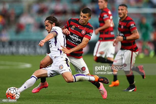 Josh Risdon of the Glory is tackled during the round four A-League match between the Western Sydney Wanderers and Perth Glory at Pirtek Stadium on...