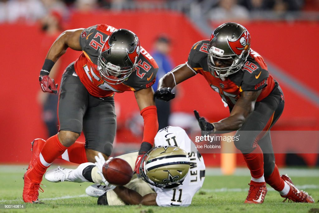 Josh Robinson #26 and Freddie Martino #16 of the Tampa Bay Buccaneers force a fumble by Tommylee Lewis #11 of the New Orleans Saints that was returned for a touchdown in the fourth quarter of a game at Raymond James Stadium on December 31, 2017 in Tampa, Florida. The Buccaneers won 31-24.