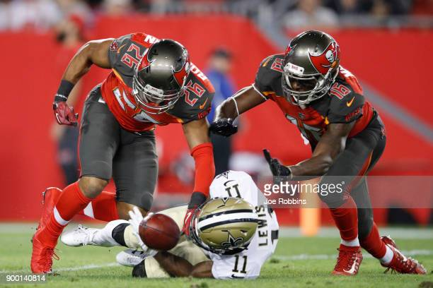 Josh Robinson and Freddie Martino of the Tampa Bay Buccaneers force a fumble by Tommylee Lewis of the New Orleans Saints that was returned for a...
