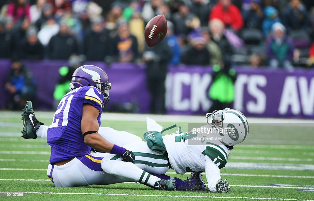Josh Robinson #21 of the Minnesota Vikings breaks up a pass intended Chris Owusu #14 of the New York Jets in the second quarter on December 7, 2014 at TCF Bank Stadium in Minneapolis, Minnesota.