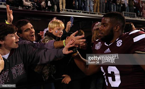 Josh Robinson of the Mississippi State Bulldogs celebrates with fans after defeating the Arkansas Razorbacks 1710 in the second half at Davis Wade...