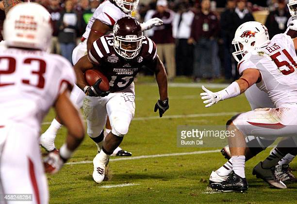 Josh Robinson of the Mississippi State Bulldogs gets by Brooks Ellis of the Arkansas Razorbacks and scores a touchdown in the first half at Davis...