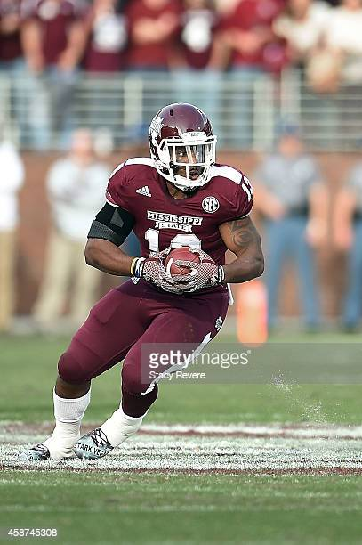 Josh Robinson of the Mississippi State Bulldogs runs for yards during a game against the Tennessee Martin Skyhawks at Davis Wade Stadium on November...