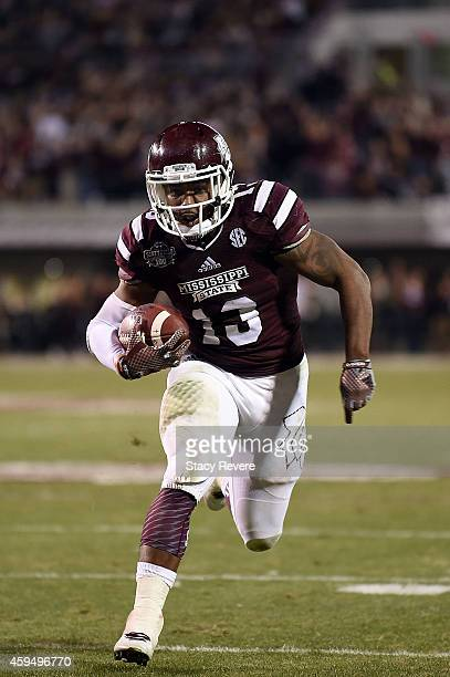 Josh Robinson of the Mississippi State Bulldogs runs for yards during a game against the Vanderbilt Commodores at Davis Wade Stadium on November 22...