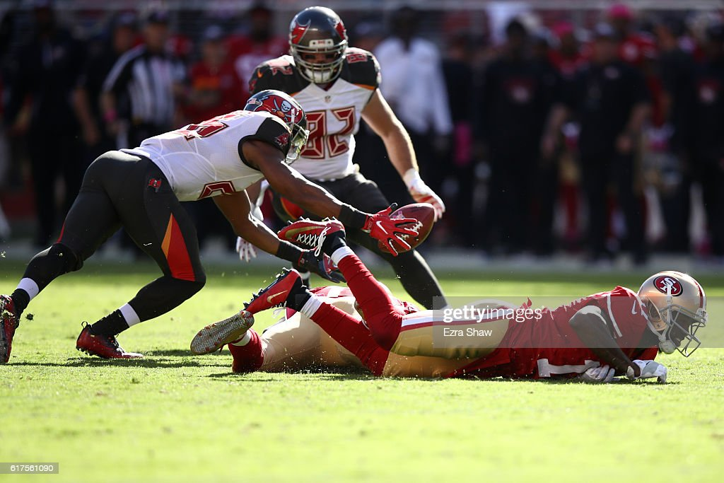 Josh Robinson #26 of the Tampa Bay Buccaneers dives for a muffed punt by Adam Humphries #11 during their NFL game against the San Francisco 49ers at Levi's Stadium on October 23, 2016 in Santa Clara, California.