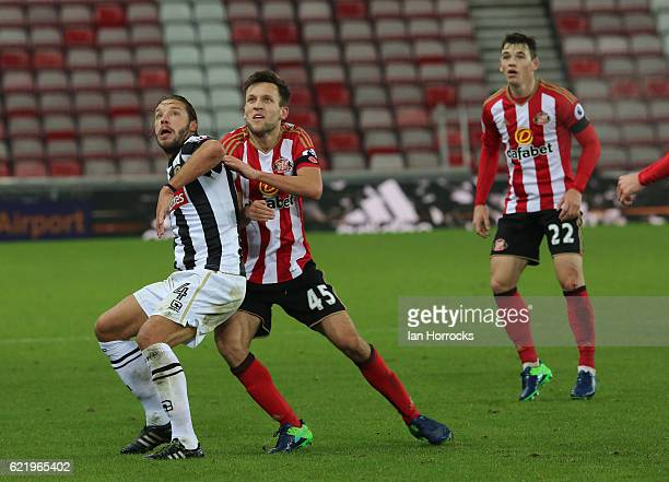 Josh Robson of Sunderland competes with Alan Smith of Notts County during the Checkatrade Trophy group stage match between Sunderland and Notts...