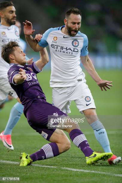 Josh Rose of Melbourne City defends Chris Harold of Perth Glory during the ALeague Elimination Final match between Melbourne City FC and the Perth...