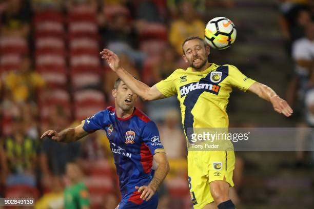 Josh Rose of the Mariners contests a header with Jason Hoffman of the Jets during the round 15 ALeague match between the Newcastle Jets and the...