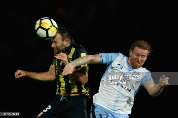 Josh Rose of the Mariners contests the header against David Carney of Sydney FC during the round 24 A-League match between the Central Coast Mariners...