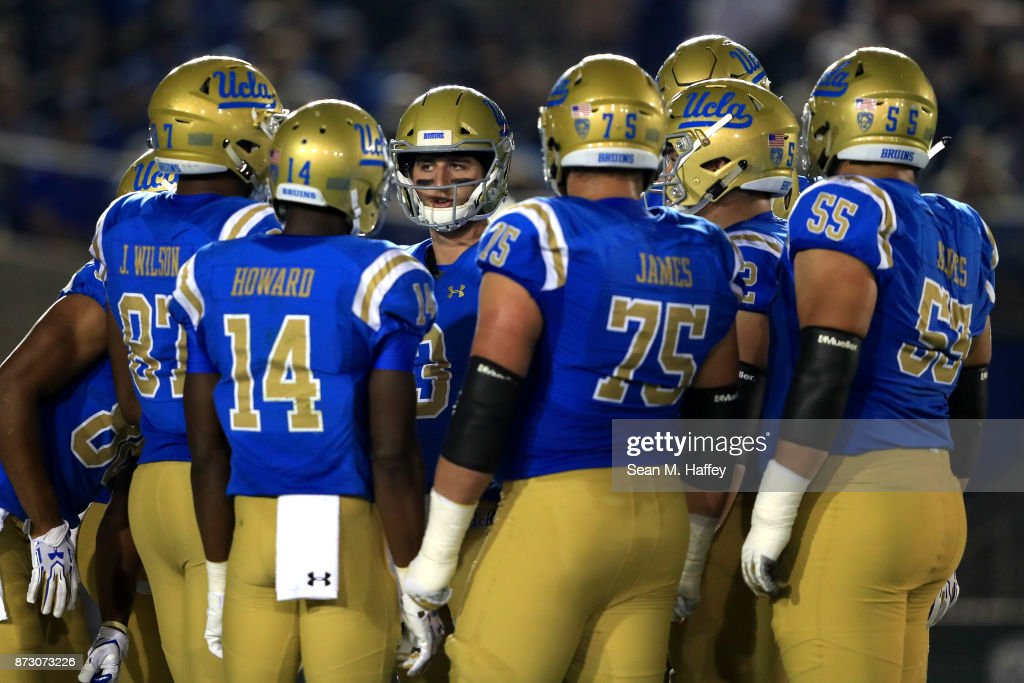 Josh Rosen #3 calls a play while Theo Howard #14, Andre James #75 and Jordan Wilson #87 of the UCLA Bruins look on during the first half of a game against the Arizona State Sun Devils at the Rose Bowl on November 11, 2017 in Pasadena, California.