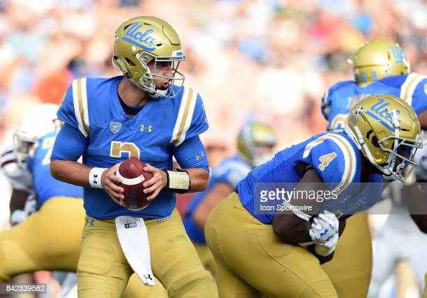 Josh Rosen drops back for a pass while UCLA Bolu Olorunfunmi blocks during a college football game between the Texas AM Aggies and the UCLA Bruins on...