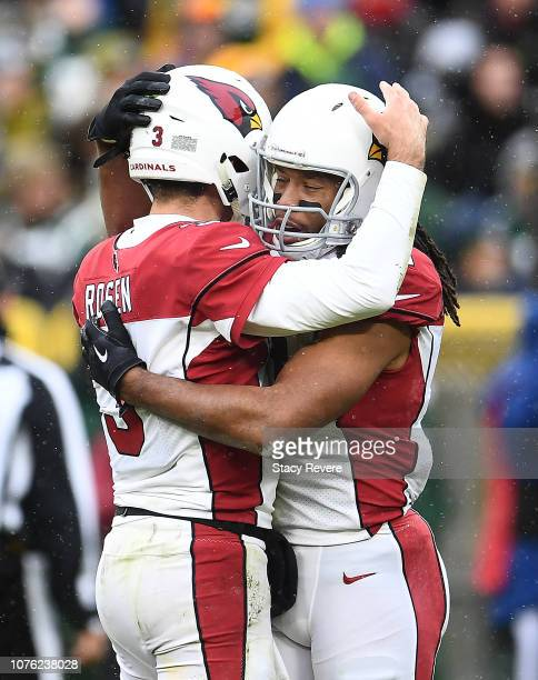 Josh Rosen of the Arizona Cardinals is congratulated by Larry Fitzgerald during the second half of a game against the Green Bay Packers at Lambeau...
