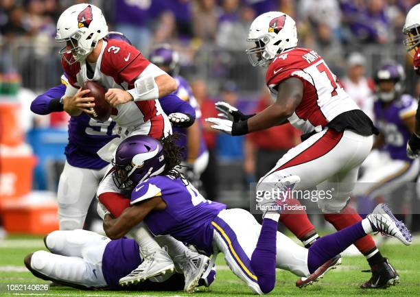 Josh Rosen of the Arizona Cardinals is sacked by Anthony Harris of the Minnesota Vikings in the first half of the game at US Bank Stadium on October...
