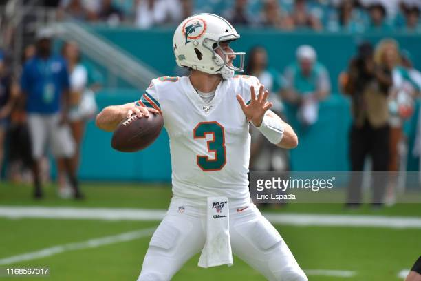 Josh Rosen of the Miami Dolphins drops back to pass during the fourth quarter of the game against the New England Patriots at Hard Rock Stadium on...