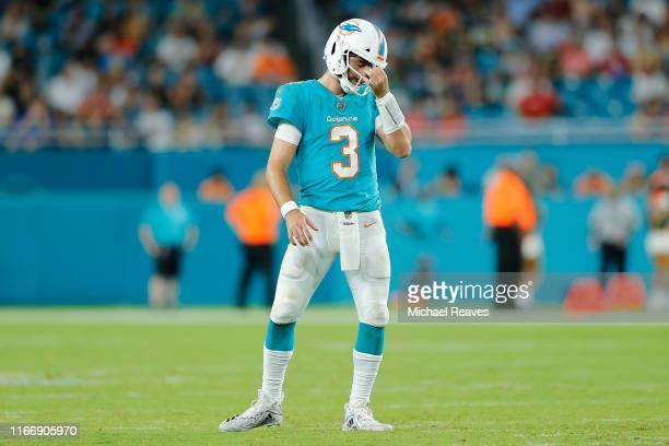 Josh Rosen of the Miami Dolphins reacts against the Atlanta Falcons during the second quarter of the preseason game at Hard Rock Stadium on August...