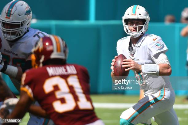 Josh Rosen of the Miami Dolphins rolls out during the first half of the game against the Washington Redskins at Hard Rock Stadium on October 13, 2019...