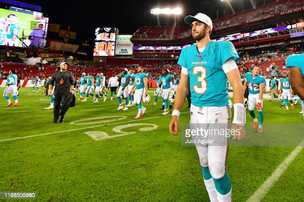 Josh Rosen of the Miami Dolphins walks on the field after a 16-14 preseason loss to the Tampa Bay Buccaneers at Raymond James Stadium on August 16,...